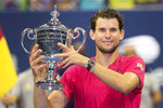 FILE - In this Sept. 13, 2020, file photo, Dominic Thiem, of Austria, holds up the championship trophy after defeating Alexander Zverev, of Germany, in the men's singles final of the U.S. Open tennis championships. in New York. After winning the U.S. Open, Thiem decided to rest at home for a bit before heading to Paris fort the French Open.(AP Photo/Frank Franklin II, File)