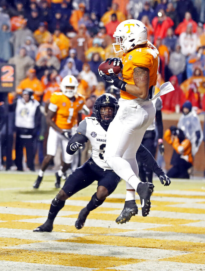 Tennessee tight end Dominick Wood-Anderson (4) catches a pass for a touchdown in front of Vanderbilt safety Tae Daley (3) in the first half of an NCAA college football game Saturday, Nov. 30, 2019, in Knoxville, Tenn. (AP Photo/Wade Payne)