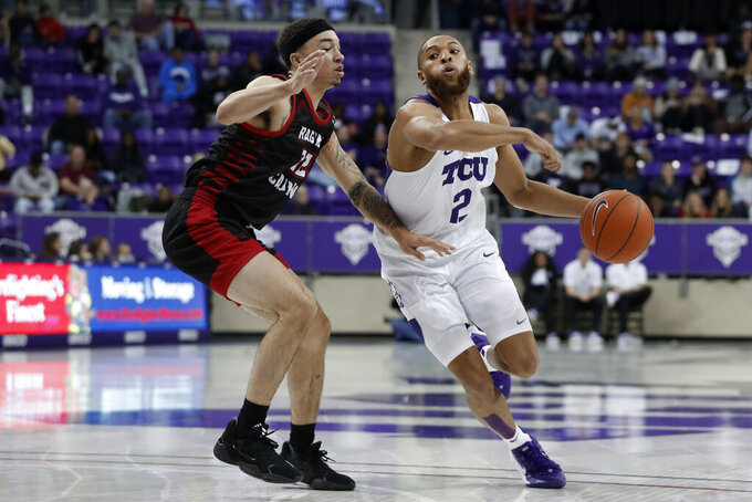 Louisiana-Lafayette guard Calvin Temple (22) defends as TCU's Edric Dennis (2) works to the basket during the second half of an NCAA college basketball game in Fort Worth, Texas, Tuesday, Nov. 12, 2019. (AP Photo/Tony Gutierrez)