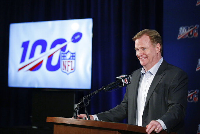 FILE - In this May 22, 2019, file photo, NFL Commissioner Roger Goodell speaks to the media during the NFL football owners meeting in Key Biscayne, Fla. The NFL would love the main focus of 2019 to be on the celebrations of its 100th season. After an egregious missed penalty (or two) that basically kept the Saints from making the Super Bowl and helped the Rams get there instead, there was little chance attention could be diverted from the guys with the whistles and their impact on games. (AP Photo/Brynn Anderson, File)