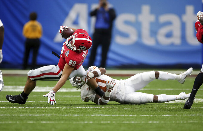 Georgia tight end Charlie Woerner (89) is tackled by Texas defensive back P.J. Locke III (11) during the first half of the Sugar Bowl NCAA college football game in New Orleans, Tuesday, Jan. 1, 2019. (AP Photo/Rusty Costanza)