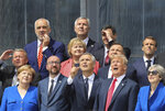 From the left, German Chancellor Angela Merkel, Belgium's Prime Minister Charles Michel, NATO Secretary General Jens Stoltenberg, US President Donald Trump, Britain's Prime Minister Theresa May, second row from the left, Denmark's Prime Minister Lars Lokke Rasmussen, Norway's Prime Minister Erna Solberg, Poland's President Andrzej Duda, French President Emmanuel Macron, third row, Albania's Prime Minister Edi Rama, Czech Republic President Milos Zeman and Spain's Prime Minister Pedro Sanchez pose for a family picture ahead of the opening ceremony of the NATO (North Atlantic Treaty Organization) summit, at the NATO headquarters in Brussels, Wednesday, July 11, 2018. (Ludovic Marin, Pool via AP)