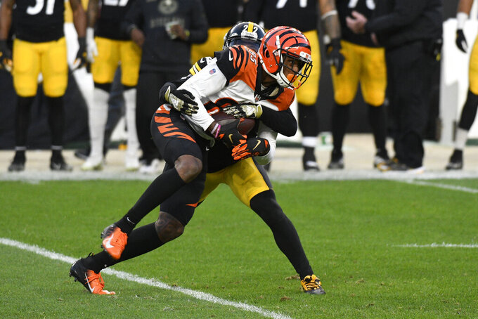Cincinnati Bengals wide receiver Tee Higgins (85) is tackled by Pittsburgh Steelers cornerback Steven Nelson (22) during the first half of an NFL football game in Pittsburgh, Sunday, Nov. 15, 2020. (AP Photo/Don Wright)