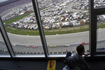 In this photo taken April 1, 2001, Luke Ford, 3, plays with a toy race car in a Lone Star penthouse condominium on Turn 2 at the Harrah's 500 at Texas Motor Speedway in Fort Worth, Texas. Fans are not allowed to watch NASCAR races live yet due to the coronavirus restrictions -- unless you happen to own a condominium overlooking a track. (Huy Nguyen/The Dallas Morning News via AP)