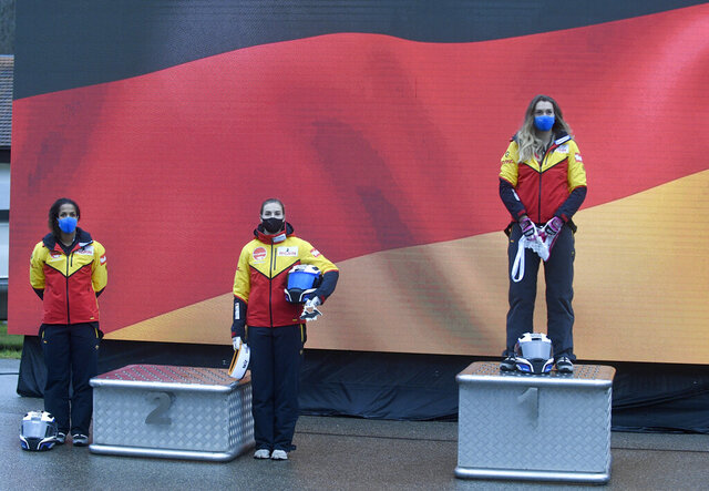 From left, second placed, Mariama Jamanka, and Kim Kalicki and first placed Laura Nolte, all of Germany celebrate during the award ceremony of the two-woman Bobsled World Cup race in Sigulda, Latvia, Saturday, Nov. 28, 2020. (AP Photo/Roman Koksarov)
