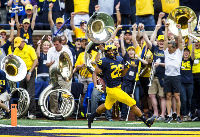 Michigan defensive back Brandon Watson (28) scores a touchdown after an interception in the fourth quarter of an NCAA college football game against Maryland in Ann Arbor, Mich., Saturday, Oct. 6, 2018. Michigan won 42-21. (AP Photo/Tony Ding)