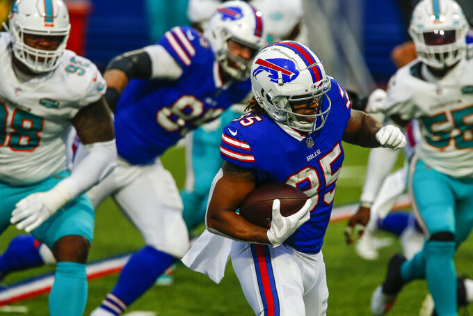 Buffalo Bills running back Antonio Williams runs in a touchdown in the second half of an NFL football game against the Miami Dolphins, Sunday, Jan. 3, 2021, in Orchard Park, N.Y. (AP Photo/John Munson)