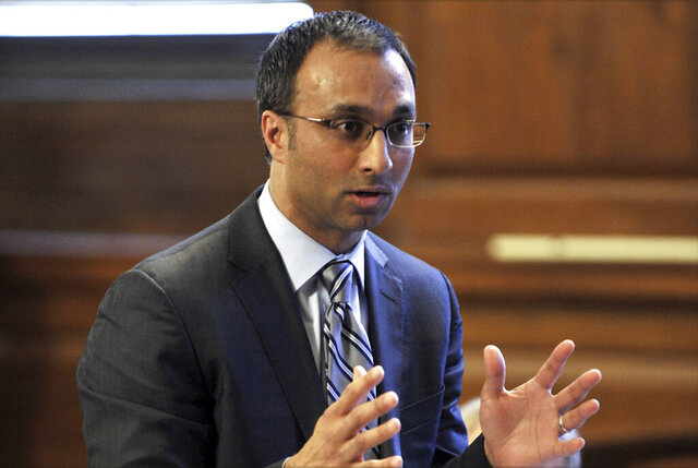 FILE - In this March 28, 2012, file photo, Amit Mehta, then the attorney for Dominique Strauss-Kahn speaks in Bronx state Supreme Court in New York. Judge Amit Mehta has ordered the Trump administration to resume issuing diversity visas for immigrants from underrepresented countries. The order issued Friday, Sept. 4, 2020 in Washington, D.C., partially reverse a pandemic-related freeze on a wide range of immigrant and temporary visas. The U.S. issues up to 55,000 visas a year to people from countries with low representation in the U.S., many in Africa. U.S. District Court Judge Amit Mehta denied requests to take similar action on other visa categories subject to bans.  (Stan Honda/Pool Photo via AP, File)