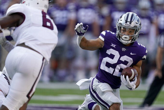 Kansas State running back Deuce Vaughn (22) runs the ball during the first half of an NCAA college football game against Southern Illinois, Saturday, Sept. 11, 2021, in Manhattan, Kan. (AP Photo/Charlie Riedel)