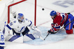Tampa Bay Lightning goaltender Andrei Vasilevskiy (88) looks at the puck after making a save against Montreal Canadiens center Eric Staal (21) during the second period of Game 4 of the NHL hockey Stanley Cup final in Montreal, Monday, July 5, 2021. (Paul Chiasson/The Canadian Press via AP)