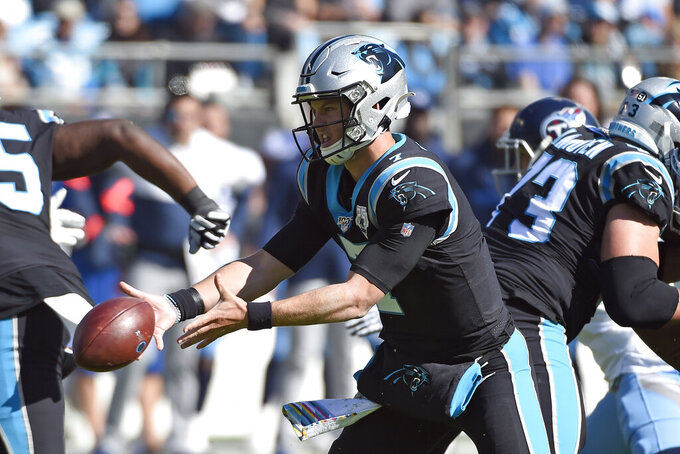 Carolina Panthers quarterback Kyle Allen tosses the ball during the first half of an NFL football game against the Tennessee Titans in Charlotte, N.C., Sunday, Nov. 3, 2019. (AP Photo/Mike McCarn)