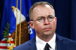 FILE- In this July 11, 2018, file photo Mick Mulvaney,  listens during a news conference at the Department of Justice in Washington. Top White House aid Mick Mulvaney on Sunday, July 28, 2019 defended President Donald Trump's disparaging tweets about Rep. Elijah Cummings and his Baltimore district as a justified response to the lawmaker's criticism of administration border policies. (AP Photo/Jacquelyn Martin, File)