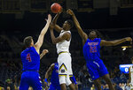 Notre Dame's Juwan Durham (11) shoots while defended by Presbyterian's Ben Drake (4) and Michael Isler (22) during an NCAA college basketball game Monday, Nov. 18, 2019, in South Bend, Ind. (Michael Caterina/South Bend Tribune via AP)