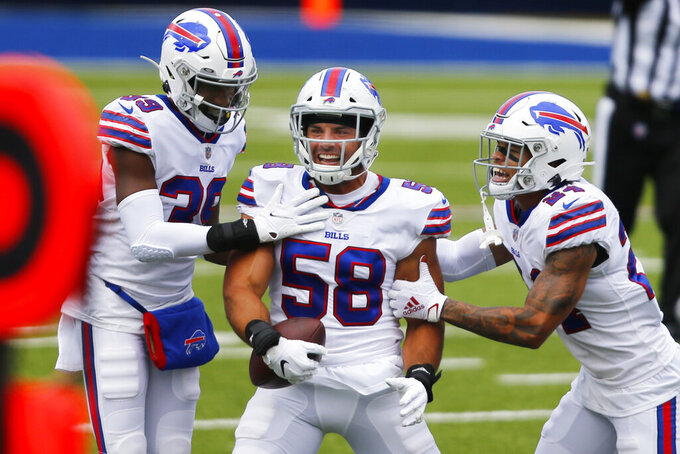 FILE - Buffalo Bills outside linebacker Matt Milano (58) is congratulated by teammates after intercepting a pass intended for New York Jets receiver Jamison Crowder (not shown) during the first half of an NFL football game in Orchard park, N.Y., in this Sunday Sept. 13, 2020, file photo. The Buffalo Bills' salary-cap constraints have led starting linebacker Matt Milano to decide he will test free agency next month, a person with direct knowledge of the situation told The Associated Press on Friday, Feb. 19, 2021. The person spoke to The AP on the condition of anonymity because the discussions between the player and team have been private. (AP/ Photo Jeffrey T. Barnes, File)