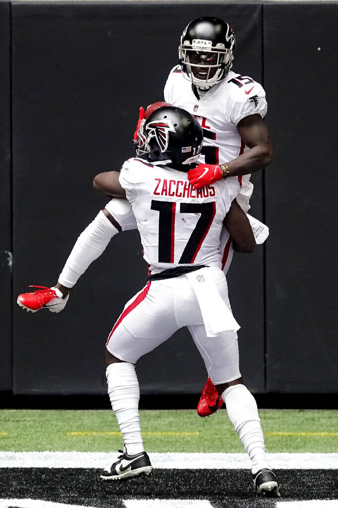 Atlanta Falcons wide receiver Olamide Zaccheaus (17) celebrates a Atlanta Falcons wide receiver Brandon Powell touchdown against the Denver Broncos during the first half of an NFL football game, Sunday, Nov. 8, 2020, in Atlanta. (AP Photo/John Bazemore)