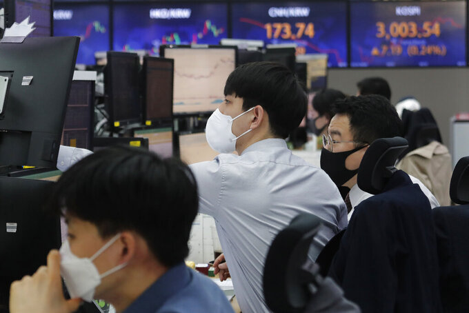 Currency traders watch monitors at the foreign exchange dealing room of the KEB Hana Bank headquarters in Seoul, South Korea, Thursday, March 25, 2021. Shares advanced in Asia on Thursday after a broad decline on Wall Street led by selling of tech heavyweights like Facebook and Apple. (AP Photo/Ahn Young-joon)