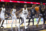 Central Florida forward Collin Smith (35) fights for the ball with Cincinnati center Nysier Brooks (33) during the first half of an NCAA college basketball game, Thursday, March 7, 2019, in Orlando, Fla. (AP Photo/Willie J. Allen Jr.)