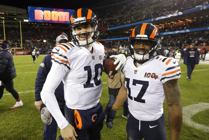 Chicago Bears quarterback Mitchell Trubisky and wide receiver Anthony Miller (17) react following an NFL football game against the Dallas Cowboys, Thursday, Dec. 5, 2019, in Chicago. Chicago won 31-24. (AP Photo/Morry Gash)