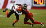 Tampa Bay Buccaneers cornerback M.J. Stewart (36) stops Cleveland Browns wide receiver Rashard Higgins (81) during the first half of an NFL preseason football game Friday, Aug. 23, 2019, in Tampa, Fla. (AP Photo/Jason Behnken)