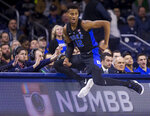 Duke's Javin DeLaurier (12) falls into the scorer's table during the first half of an NCAA college basketball game against Notre Dame Monday, Jan. 28, 2019, in South Bend, Ind. (AP Photo/Robert Franklin)