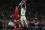 Detroit Pistons forward Markieff Morris, left, blocks a shot by Boston Celtics forward Grant Williams during the first half of an NBA basketball game in Boston, Wednesday, Jan. 15, 2020. (AP Photo/Charles Krupa)