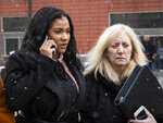Joycelyn Savage, one of R&B singer R. Kelly's girlfriends, walks out of the Cook County Domestic Violence Courthouse with with her attorney Lori Levin, Thursday morning, Jan. 23, 2020, in Chicago. Savage pleaded not guilty to a misdemeanor battery charge for allegedly punching another of the the R&B singer's girlfriends in the face. (Ashlee Rezin Garcia/Chicago Sun-Times via AP)