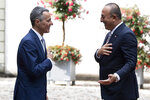 Swiss Federal Councilor Ignazio Cassis, left, and Mevluet Cavusoglu, right, Foreign Minister of Turkey, talk during an official visit in Bern, Switzerland, Friday, Aug. 14, 2020. (Peter Schneider/Keystone via AP)