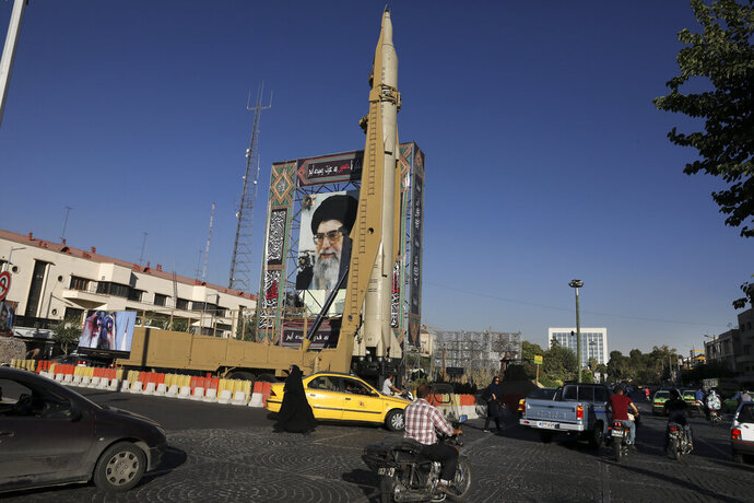 A Shahab-3 surface-to-surface missile is on display next to a portrait of Iranian Supreme Leader Ayatollah Ali Khamenei at an exhibition by Iran's army and paramilitary Revolutionary Guard celebrating