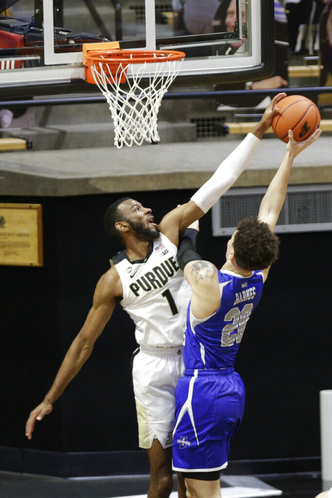 Purdue forward Aaron Wheeler (1) goes up to block the shot of Indiana State guard Cobie Barnes (20) during the first half of an NCAA men's basketball game, Saturday, Dec. 12, 2020, in West Lafayette, Ind. (Nikos Frazier/Journal & Courier via AP)
