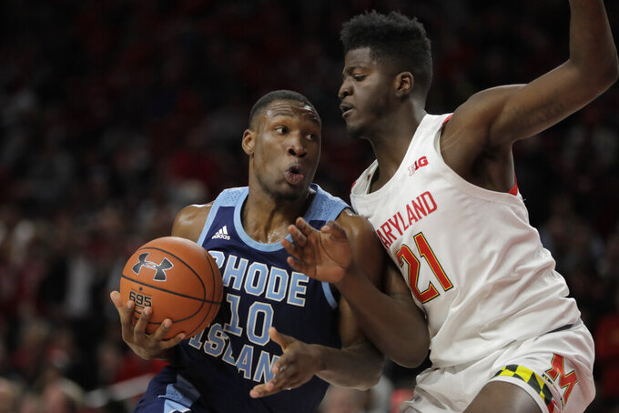 Rhode Island forward Cyril Langevine (10) drives to the basket against Maryland forward Makhi Mitchell (210 during the second half of an NCAA college basketball game, Saturday, Nov. 9, 2019, in College Park, Md. (AP Photo/Julio Cortez)