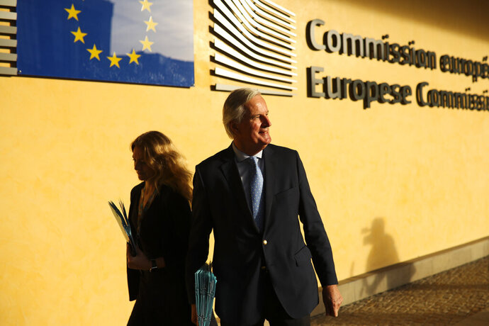 European Union chief Brexit negotiator Michel Barnier goes for a meeting about Brexit outside the EU headquarters in Brussels, Friday, Oct. 25, 2019. European Union ambassadors are meeting in Brussels Friday to discuss what kind of extension to the Brexit deadline they could propose to Britain. (AP Photo/Francisco Seco)