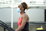 Venus Williams enters center court at the WTA tennis tournament in Nicholasville, Ky., wearing a face mask Thursday, Aug. 13, 2020. (AP Photo/Timothy D. Easley)