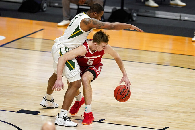 IWisconsin forward Tyler Wahl (5) tries to drive around Baylor guard Mark Vital (11) n the first half of a second-round game in the NCAA men's college basketball tournament at Hinkle Fieldhouse in Indianapolis, Sunday, March 21, 2021. (AP Photo/Michael Conroy)