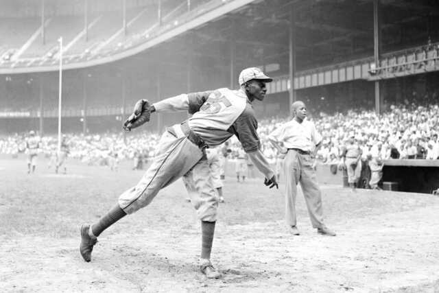FILE - In this Aug. 2, 1942, file photo, Kansas City Monarchs pitcher Leroy Satchel Paige warms up at New York's Yankee Stadium before a Negro League game between the Monarchs and the New York Cuban Stars. Major League Baseball has reclassified the Negro Leagues as a major league and will count the statistics and records of its 3,400 players as part of its history. The league said Wednesday, Dec. 16, 2020, it was