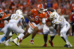 Clemson quarterback D.J. Uiagalelei (5) runs through the line as Georgia Tech's Ayinde Eley (10) and D'Quan Douse (99) close in during the second half of an NCAA college football game, Saturday, Sept. 18, 2021, in Clemson, S.C. (AP Photo/John Bazemore)