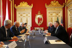 US Secretary of State Mike Pompeo, right, talks with Portuguese Foreign Minister Augusto Santos Silva, 2nd left during a meeting at the Foreign Ministry in Lisbon Thursday, Dec. 5, 2019. (AP Photo/Armando Franca)