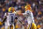 LSU quarterback Joe Burrow (9) celebrates with wide receiver Ja'Marr Chase (1) on their touchdown pass play during the second half of the team's NCAA college football game against Texas A&M in Baton Rouge, La., Saturday, Nov. 30, 2019. LSU won 50-7. (AP Photo/Gerald Herbert)