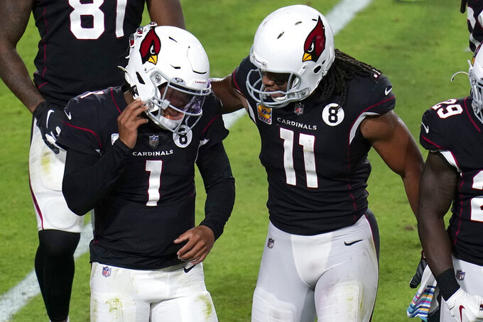 Arizona Cardinals quarterback Kyler Murray (1) celebrates his touchdown with wide receiver Larry Fitzgerald (11) during the second half of an NFL football game against the Seattle Seahawks, Sunday, Oct. 25, 2020, in Glendale, Ariz. (AP Photo/Ross D. Franklin)