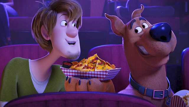 This image released by Warner Bros. Pictures shows characters Shaggy, voiced by Will Forte, left, and Scooby-Doo, voiced by Frank Welker, in a scene from the animated film