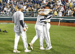 Vanderbilt coach Tim Corbin, right, celebrates with players after Vanderbilt defeated Michigan to win Game 3 of the NCAA College World Series baseball finals in Omaha, Neb., Wednesday, June 26, 2019. (AP Photo/John Peterson)