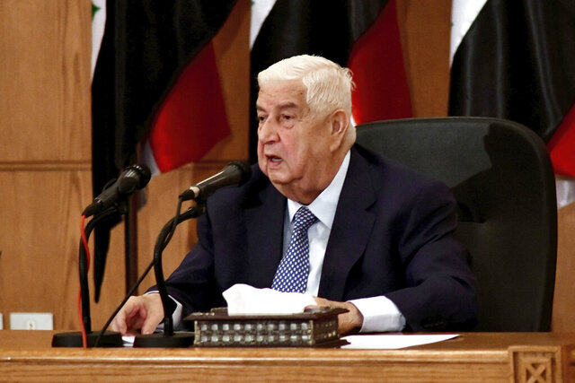 In this photo released by the Syrian official news agency SANA, Syrian Foreign Minister Walid al-Moallem speaks during a press conference, in Damascus, Syria, Tuesday, June 23, 2020. Walid al-Moallem accused the United States on Tuesday of allegedly