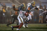 Navy quarterback Xavier Arline (7) rushes during the first half of an NCAA college football game against Army on Saturday, Dec. 12, 2020, in West Point, N.Y. (AP Photo/Adam Hunger)