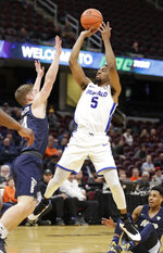 FILE - In this March 14, 2019, file photo, Buffalo's CJ Massinburg (5) shoots over Akron's Scott Walter (14) during the first half of an NCAA college basketball game of the Mid-American Conference tournament,  in Cleveland. Buffalo battles Arizona State in West Region action on Friday, March 22. (AP Photo/Tony Dejak, File)
