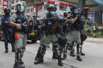 Hong Kong riot police fire tear gas as hundreds of protesters march along a downtown street during a pro-democracy protest against Beijing's national security legislation in Hong Kong, Sunday, May 24, 2020. Hong Kong's pro-democracy camp has sharply criticised China's move to enact national security legislation in the semi-autonomous territory. They say it goes against the