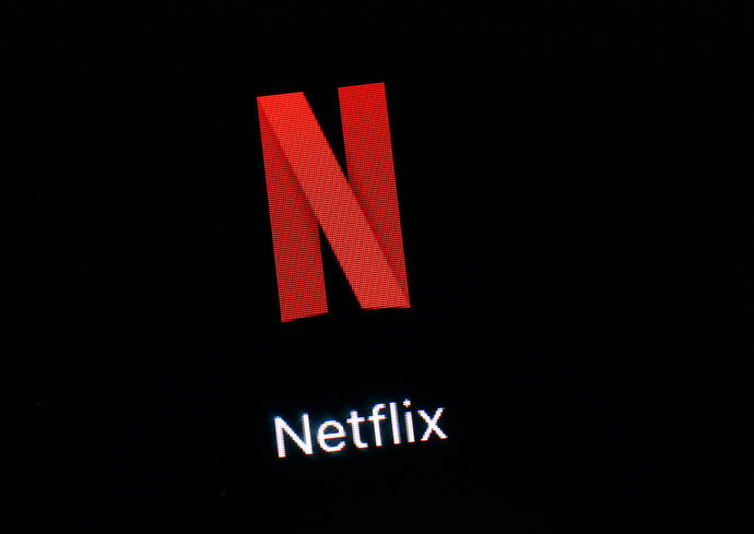 FILE- This March 19, 2018, file photo shows the Netflix app on an iPad in Baltimore. Shares of Netflix could open in negative territory for the year, the first time that's happened since 2016, as major media players step into the stream to fight for subscribers. (AP Photo/Patrick Semansky, File)
