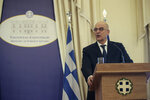 Greek Foreign Minister Nikos Dendias, speaks at the Foreign Ministry in Athens, during a handover ceremony, on Tuesday, July 9, 2019. Greece's new Cabinet was sworn in Tuesday, two days after conservative party leader Kyriakos Mitsotakis won early elections on pledges to make the country more business-friendly, cut taxes and negotiate an easing of draconian budget conditions agreed as part of the country's rescue program. (AP Photo/Petros Giannakouris)