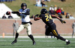Vanderbilt quarterback Kyle Shurmur, left, throws under pressure from Missouri linebacker Terez Hall during the first half of an NCAA college football game Saturday, Nov. 10, 2018, in Columbia, Mo. (AP Photo/Jeff Roberson)