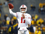 FILE - In this Oct. 13, 2018, file photo, Wisconsin quarterback Jack Coan throws before an NCAA college football game against Michigan, in Ann Arbor, Mich. Four scholarship quarterbacks are competing for the starter's job at Wisconsin. Coan is the only quarterback with significant experience following the departure of three-year starter Alex Hornibrook, who went to Florida State as a graduate transfer. (AP Photo/Paul Sancya, File)