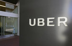 FILE - This March 1, 2017, file photo shows an exterior view of the headquarters of Uber in San Francisco. Officials in a southwestern Oregon city have cleared the way for Uber and Lyft to begin operation. The Ashland Daily Tidings reports the Ashland City Council on Tuesday, Feb. 19, 2019, overruled the mayor's veto of an ordinance that allows for ride-hailing services. (AP Photo/Eric Risberg, File)