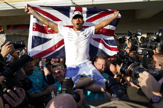 Mercedes driver Lewis Hamilton, of Britain, celebrates following the Formula One U.S. Grand Prix auto race at the Circuit of the Americas, Sunday, Nov. 3, 2019, in Austin, Texas. (AP Photo/Chuck Burton)